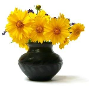 Vase of yellow flowers 300x295