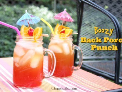 Take that sweet tea up a notch with this Boozy Back Porch Punch, a delicious late summer honey whiskey drink.