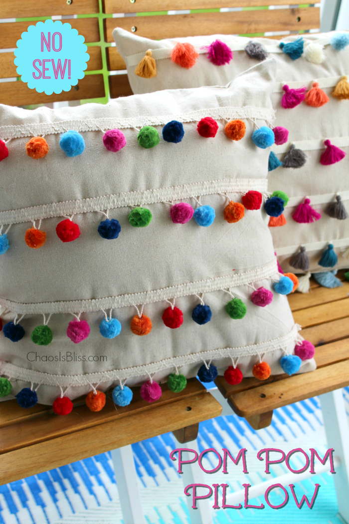 You won't believe how easy it is to make this DIY No Sew Pom Pom Pillow!
