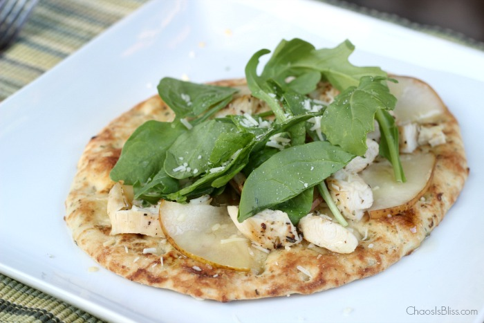 Arugula flatbread with pears, chicken, blue cheese and a made-from-scratch honey lime dressing is an easy dinner recipe for family or friends!
