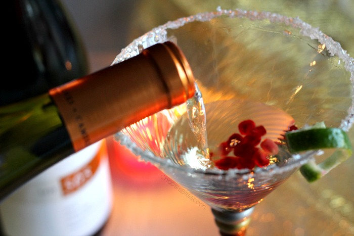 Include a festive holiday cocktail in your party planning, like this Pomegranate Wine Spritzer!