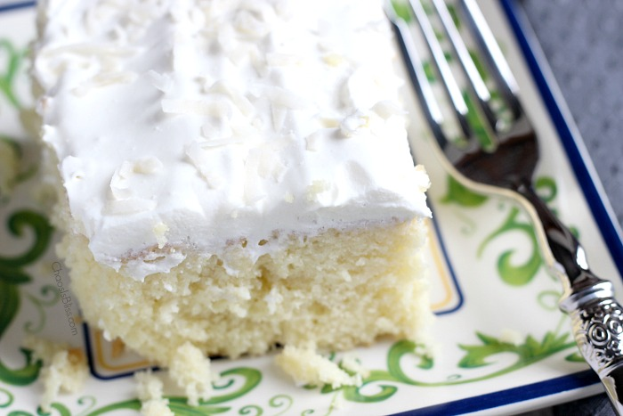 Light, moist and easy to make, this Coconut Cake poke cake recipe will be a favorite twist on a box cake mix recipe you'll savor all through the year!
