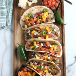 Drop these fresh ingredients into your slow cooker, and a few hours later your family will feast on savory Slow Cooker Pork Tacos!